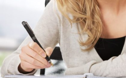 Dear procrastiwriter - writing in a notebook