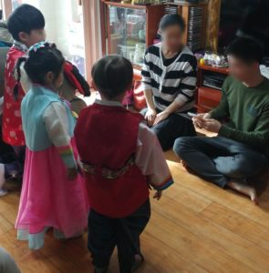 The Monsta learning Korean traditions